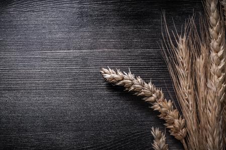 copyspace: Bunch of wheat and rye ears on wooden board copyspace.