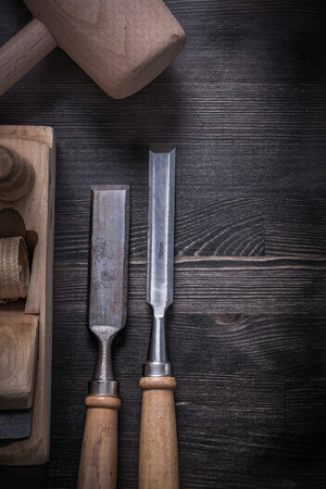 wood planer: Firmer chisels planer lump hammer on wood board construction concept.