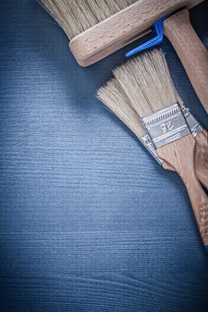 repaint: Collection of paint brushes on wood board construction concept. Stock Photo