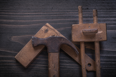 gage: Composition of vintage wooden claw hammer square ruler and marking gage.