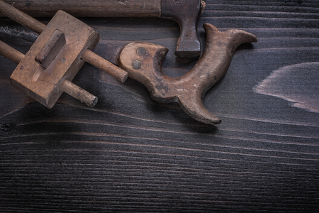 gage: Horizontal view of longstanding hand saw marking gage claw hammer.