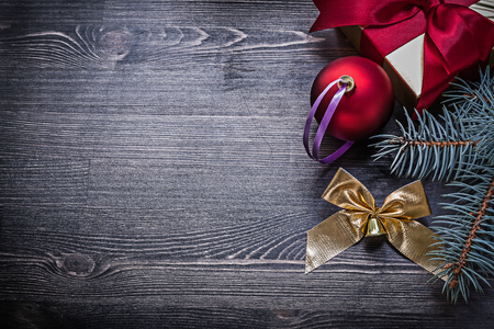 fir twig: Christmas bauble bow fir twig present box on wood board. Stock Photo