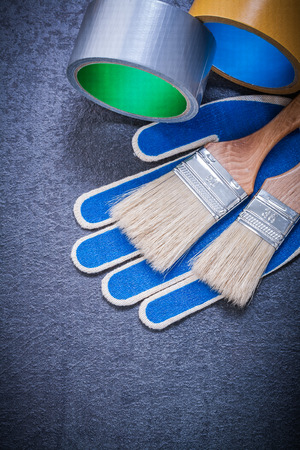 repaint: Set of household tape paint brushes safety gloves construction concept.