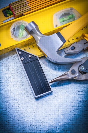 square ruler: Square ruler construction level pliers wooden meter hammer tin snips.