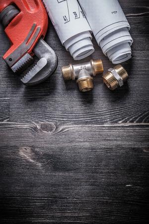 household fixture: Monkey wrench copper plumbing fixtures blueprint rolls.