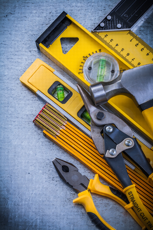 toolset: Set of construction tools on scratched metallic background.