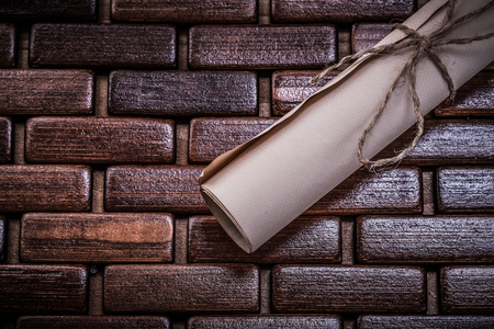 rolled paper: Vintage rolled paper on wicker wooden mat.
