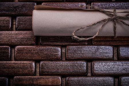 matting: Vintage scroll of paper on wooden matting.