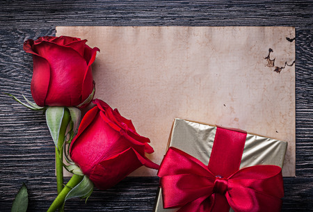 invitation cards: Vintage clean paper red natural roses giftbox on wooden board.