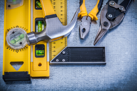 toolset: Try square construction level claw hammer pliers steel cutter.