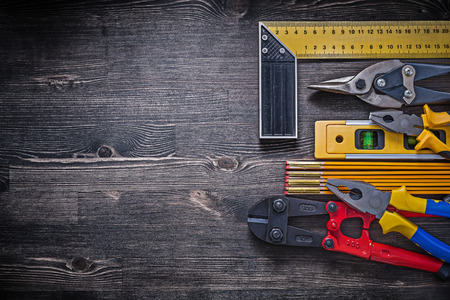 construction level: Square ruler pliers construction level wooden meter steel wire cutter.