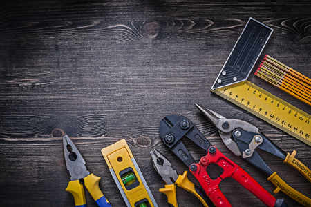 snips: Square ruler pliers construction level wooden meter sharp tin snips. Stock Photo