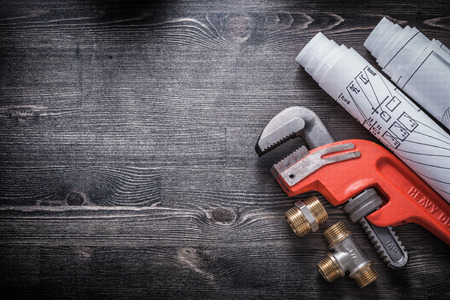 Monkey wrench brass plumbing fittings construction plans. Stock Photo
