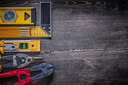 snips: Square ruler pliers construction level wooden meter tin snips copyspace. Stock Photo