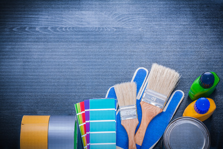 repaint: Set of painting tools on wooden board construction concept.