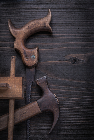 claw hammer: Rusted hand saw vintage marking gauge claw hammer vertical image.