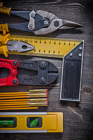 square ruler: Square ruler pliers construction level wooden meter tin snips.