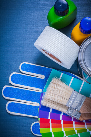 pantone: Paint containers pantone fan safety gloves paintbrushes household tape.