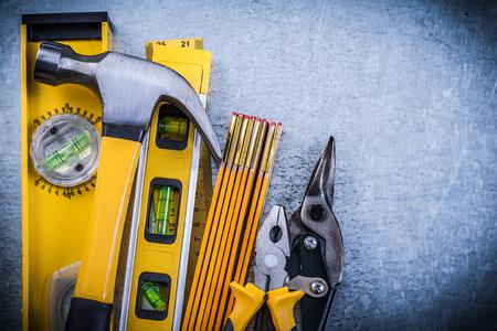 toolset: Set of construction level hammer pliers steel cutter wooden meter.
