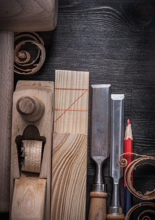 scobs: Top view of chisels planer wooden chips plank mallet pencil.