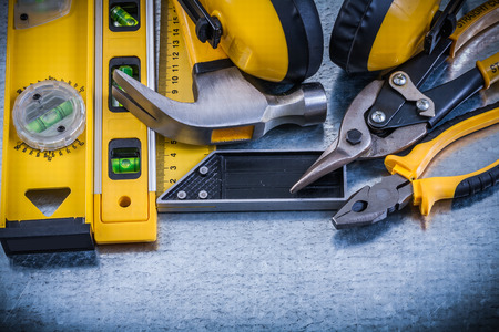 Earmuffs: Try square construction level claw hammer pliers steel cutter earmuffs.