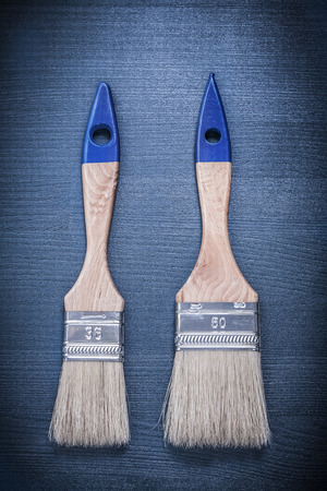 bristle: Paintbrushes on wooden board construction concept.
