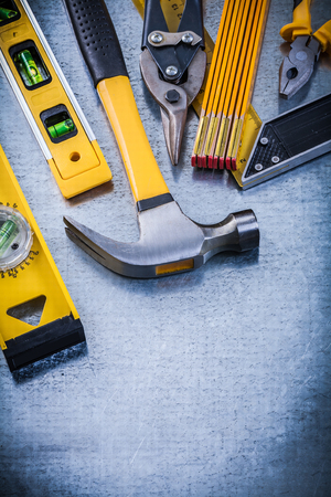 toolset: Try square construction level hammer pliers tin snips wooden meter. Stock Photo