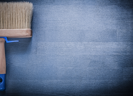 bristle: Paint brush with thick bristle on wooden board construction concept.
