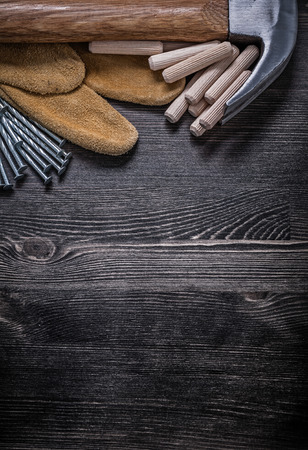 claw hammer: Safety gloves metal construction nails claw hammer wooden dowels.