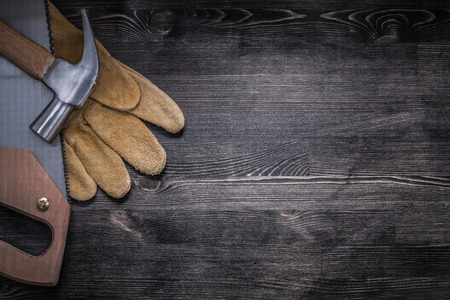 claw hammer: Set of hack-saw claw hammer safety leather gloves copyspace.