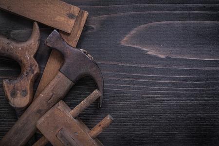 square ruler: Obsolete hand saw wooden marking gauge claw hammer square ruler.