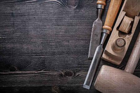 chisels: Wooden hammer flat chisels planer on wood board copyspace. Stock Photo
