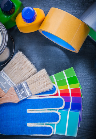 sampler: Paint can bottle color sampler protective gloves paintbrushes adhesive tape. Stock Photo