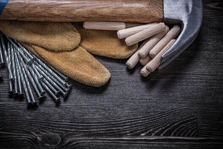 claw hammer: Protective gloves construction nails claw hammer wooden dowels.