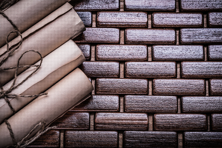 matting: Rolled up ancient documents on wicker wooden matting.