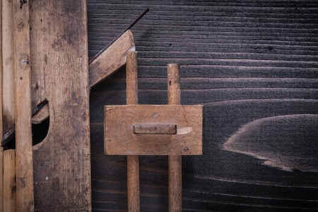 planer: Wooden retro-styled marking gauge planer on wood board construction concept.