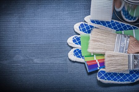 pantone: Paintbrushes can pantone fan safety gloves household tape. Stock Photo