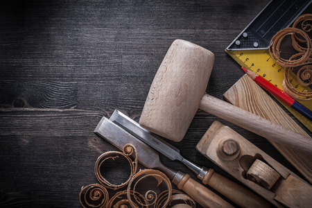 Set of joiner tools on wooden board construction concept. Stock Photo