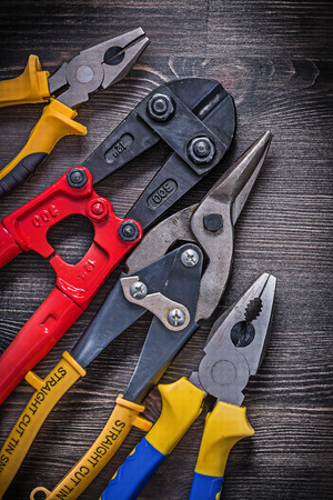 snips: Set of tin snips steel cutter pliers on wooden background. Stock Photo