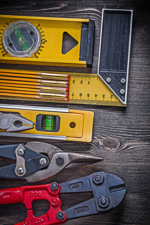 construction level: Square ruler pliers construction level wooden meter sharp wire cutter.