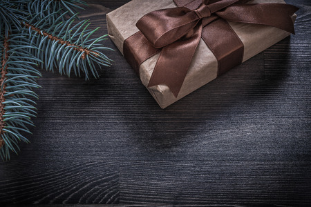 evergreen tree: Evergreen tree present box on wooden board holiday concept.