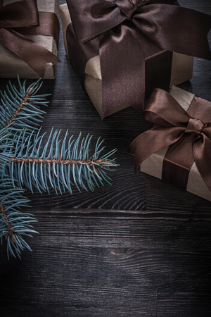 evergreen tree: Evergreen tree Christmas gift boxes on wooden board holiday concept.