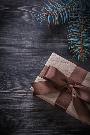 evergreen tree: Evergreen tree giftbox on wooden board holiday concept.
