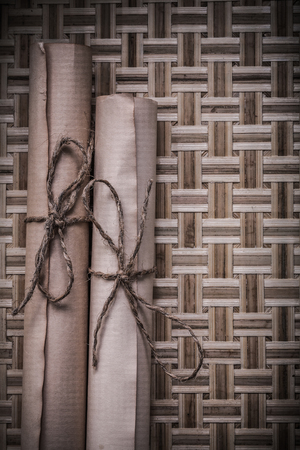 matting: Antique medieval parchment on wicker wooden matting.