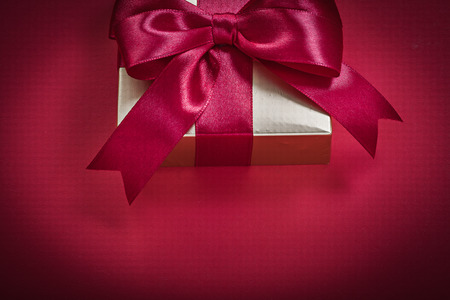 giftbox: Giftbox with present tape on red background holidays concept.