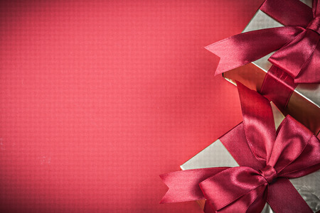 red glittery: Giftboxes on red background top view holidays concept. Stock Photo