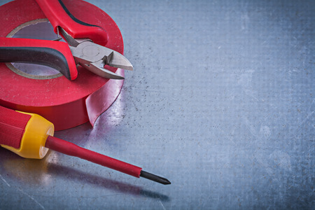 nippers: Insulation tape nippers insulated screwdriver construction concept. Stock Photo