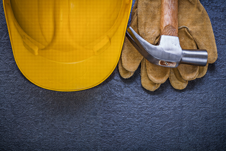 hard hat: Safety hard hat leather gloves claw hammer construction concept.