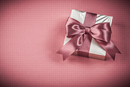 red glittery: Present box on red background holidays concept. Stock Photo