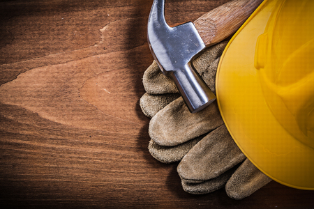 building safety: Claw hammer building helmet safety gloves construction concept.
